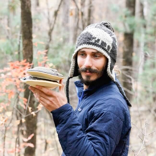 Mason Taylor holding a Reishi mushroom